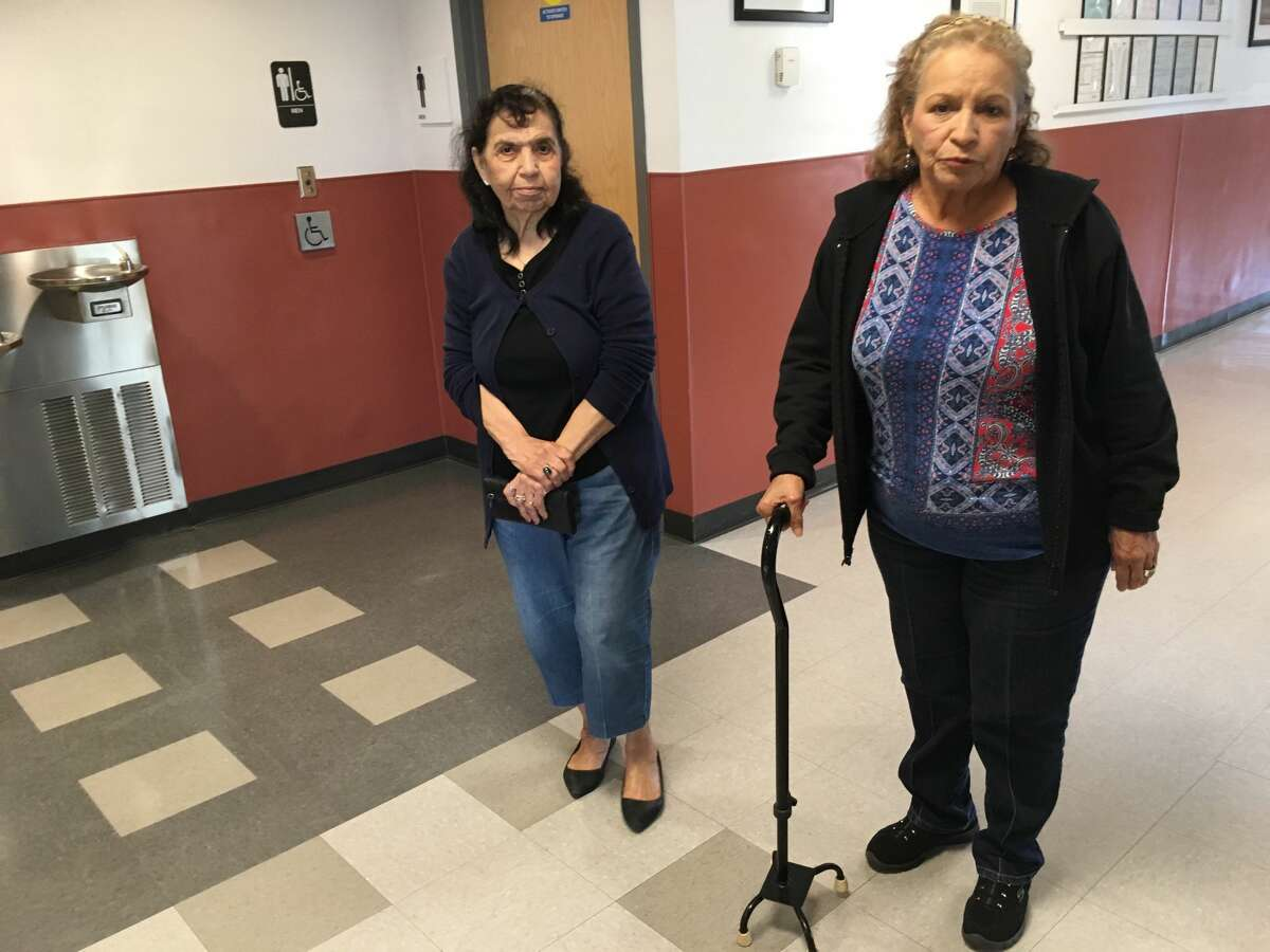 Alice Marin, right, 76, of the East End, hoped to vote on March 6, 2018. She doesn't know if she can find a way to her new voting location. She showed up to vote in the Democratic primary at Ripley Neighborhood Centers Inc. which used to be her polling site.
