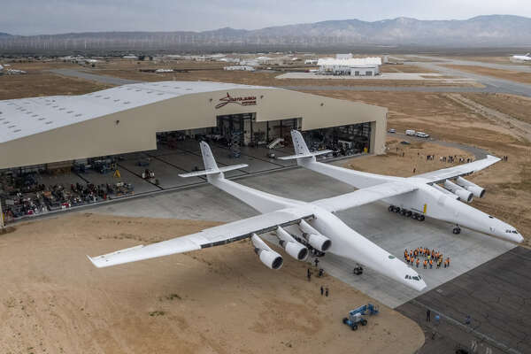Paul Allen's Stratolaunch airplane emerges from its hangar in Mojave, California on May 31, 2017.