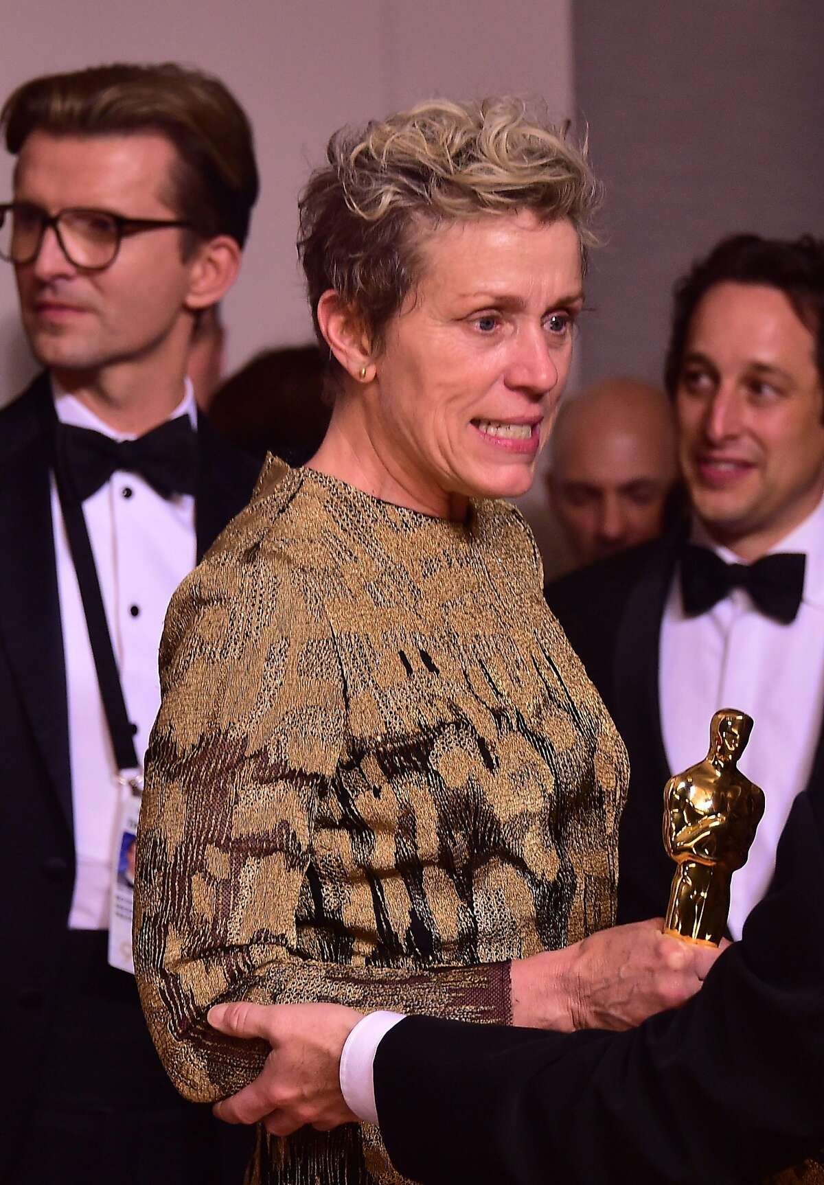 (FILES) In this file photo taken on March 4, 2018 actress Frances McDormand poses in the press room with the Oscar for best actress during the 90th Annual Academy Awards in Hollywood, California. Oscar-winner Frances McDormand had her statuette stolen at a post-show party by a man who allegedly snatched it from her table before he was arrested, witnesses and police said March 5, 2018. McDormand, 60, won best actress for her role as a rage-filled mother seeking justice for her murdered daughter in Martin McDonagh's