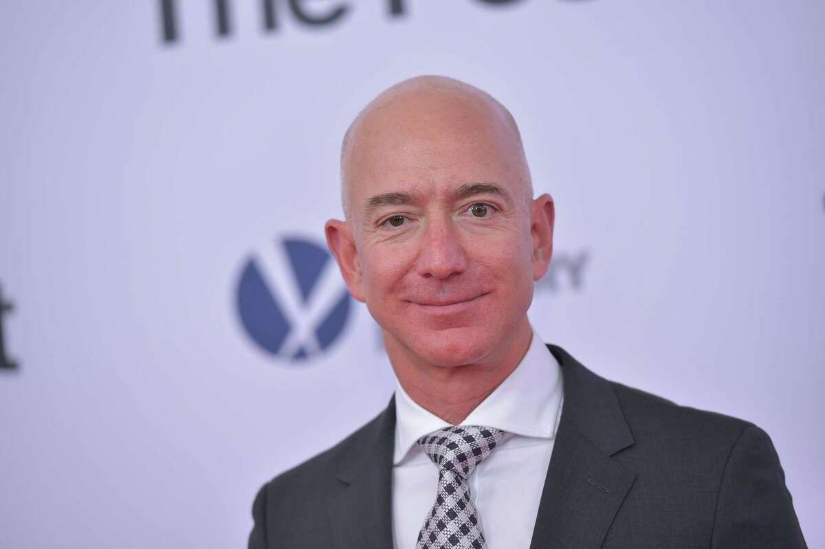 Amazon founder Jeff Bezos makes $4,474,885 per hour. Keep clicking to see lower earning billionaires.