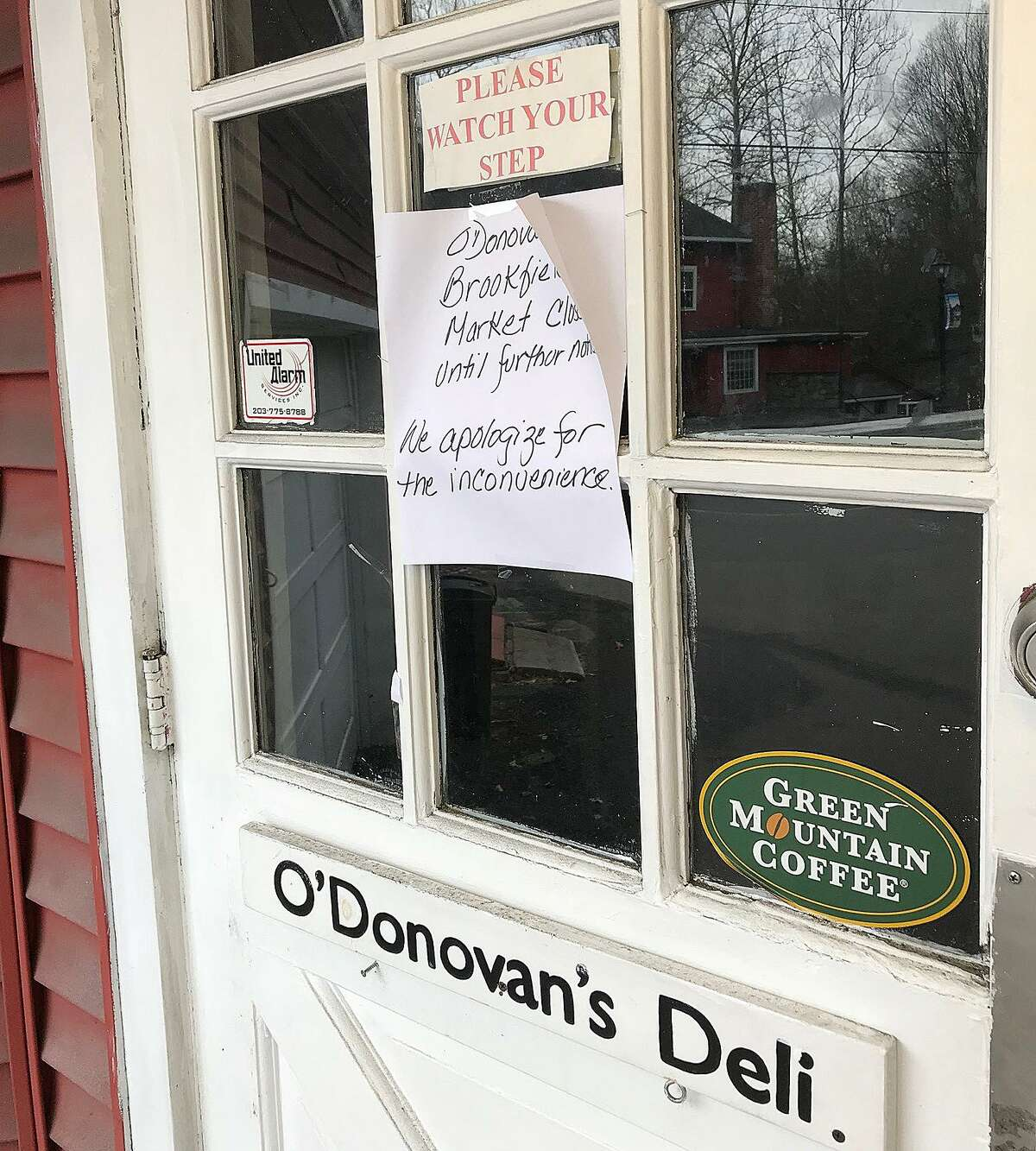 A sign on the door reads that O'Donovan's Deli is closed on Monday, March 5, 2018, in Brookfield, Conn.