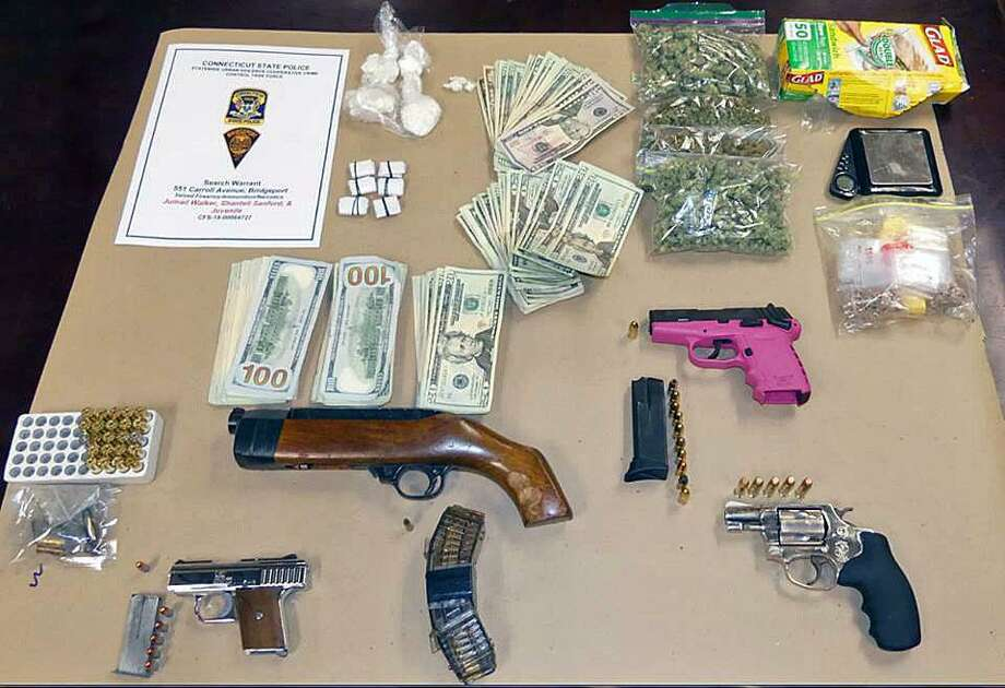 On Feb. 22, 2018, members of the Statewide Urban Violence Cooperative Crime Control Task Force, assisted by the Bridgeport Emergency Services Unit and the Statewide Narcotics Task Force executed a search warrant at a residence in the 500 block of Carroll Avenue in Bridgeport, Conn. Photo: Contributed Photo / Connecticut State Police / Contributed Photo / Connecticut Post Contributed