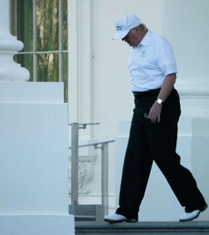 US President Donald Trump walks from the White House to his motorcade before traveling to his Virginia golf club on October 21.(BRENDAN SMIALOWSKI/AFP/Getty Images) Photo: BRENDAN SMIALOWSKI / This content is subject to copyright.