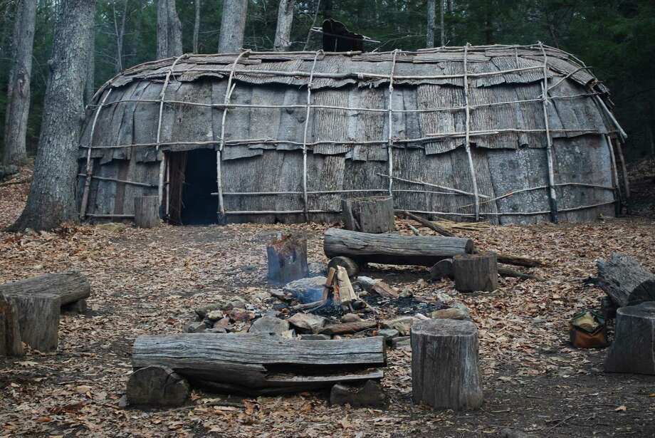 Traditions of the Algonquian Indians, who lived in northwestern Connecticut's Litchfield Hills, are kept alive in many fascinating ways at the Institute for American Indian Studies, Curtis Road, Washington. Above, the institute's Algonquian village, where the Maple Sugaring Festival will be held on Saturday, March 10. Photo: Photo Courtesy Of The Institute For American Indian Studies