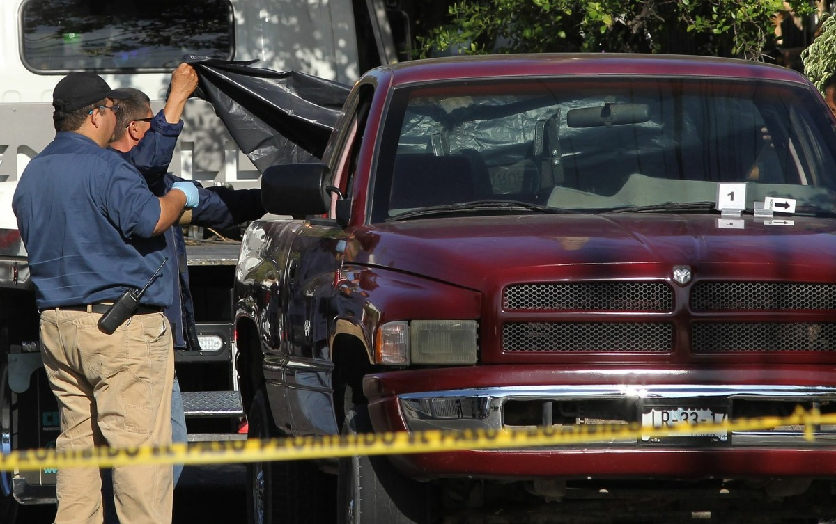 Officials said Wednesday eight hacked-up bodies were found in a pickup truck abandoned in the city of Guadalajara.