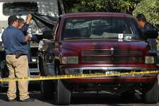 State prosecutors inspect a pick-up truck found abandoned with the bodies of six men, some of them decapitated, which are though to have been killed by alleged traffickers of a rival cartel, in Morelos neighbourhood in Guadalajara, Mexico, on March 6, 2018. Mexico has suffered a wave of violence linked to drug trafficking that has intensified in recent years. Authorities registered 25,339 murders in 2017, the most violent year since official data-keeping began in 1997. / AFP PHOTO / ULISES RUIZ (Photo credit should read ULISES RUIZ/AFP/Getty Images)