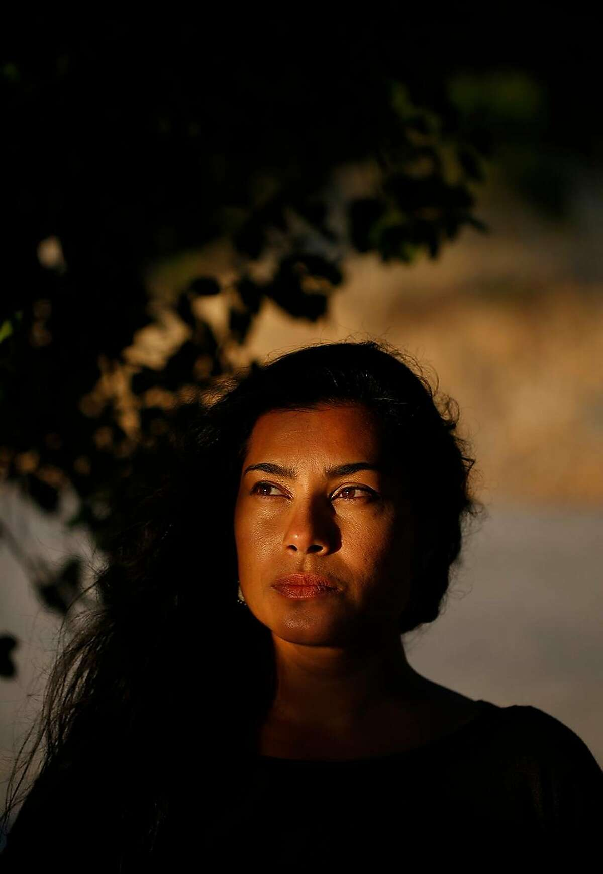Sara Tasneem poses for a portrait at her home in El Sobrante, Calif. Tasneem was legally married off by her father at the age of 15 to a much older man in Nevada. Tasneem has withdrawn her support from SB273,
