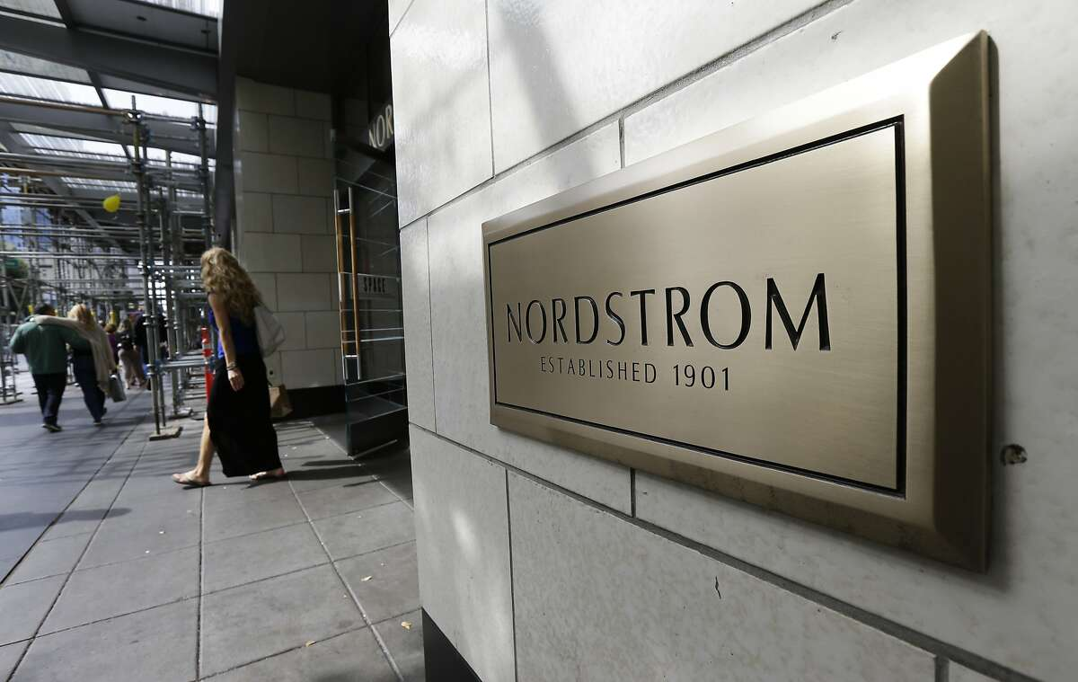 """In this Sept. 13, 2017, photo, shoppers come and go from Nordstrom Inc.'s flagship store in downtown Seattle. Department store operator Nordstrom said Monday, March 5, 2018, it had rejected a takeover offer from members of the Nordstrom family, calling the price """"inadequate."""" (AP Photo/Ted S. Warren, File)"""