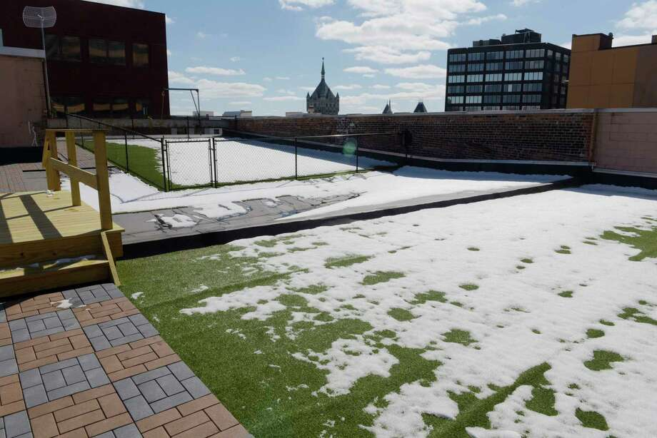 A view of the rooftop patio with a fenced-in dog park at the Residences at Capital Center on Tuesday, March 6, 2018, in Albany, N.Y.    (Paul Buckowski/Times Union) Photo: PAUL BUCKOWSKI, Albany Times Union / (Paul Buckowski/Times Union)