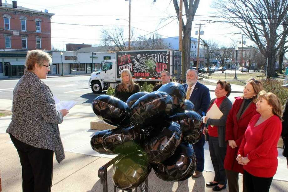 The Rev. Kathryn King, pastor of the First Congregational Church of West Haven, leads, from left, Mayor Nancy Rossi, former City Council Chairman Nick Pascale, state Rep. Charles J. Ferraro, R-West Haven, mayoral aide Ruth G. Torres, state Rep. Dorinda Borer, D-West Haven, and City Clerk Deborah Collins in a prayer service Tuesday morning, March 6,2018 for West Haven's victims of opioid addiction. The solemn ceremony, held on the steps of City Hall, marked West Haven's observance of Black Balloon Day. Photo: Contributed Photo / Michael P. Walsh - City Of West Haven