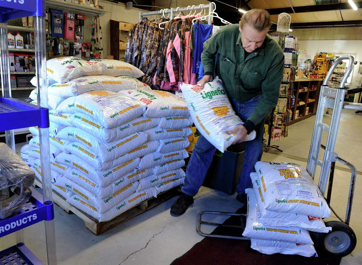 Bob Slodowski of New Fairfield buys wood pellets at Village Hardware in New Fairfield Tuesday, March 6, 2018. A major storm is expected for Wednesday.
