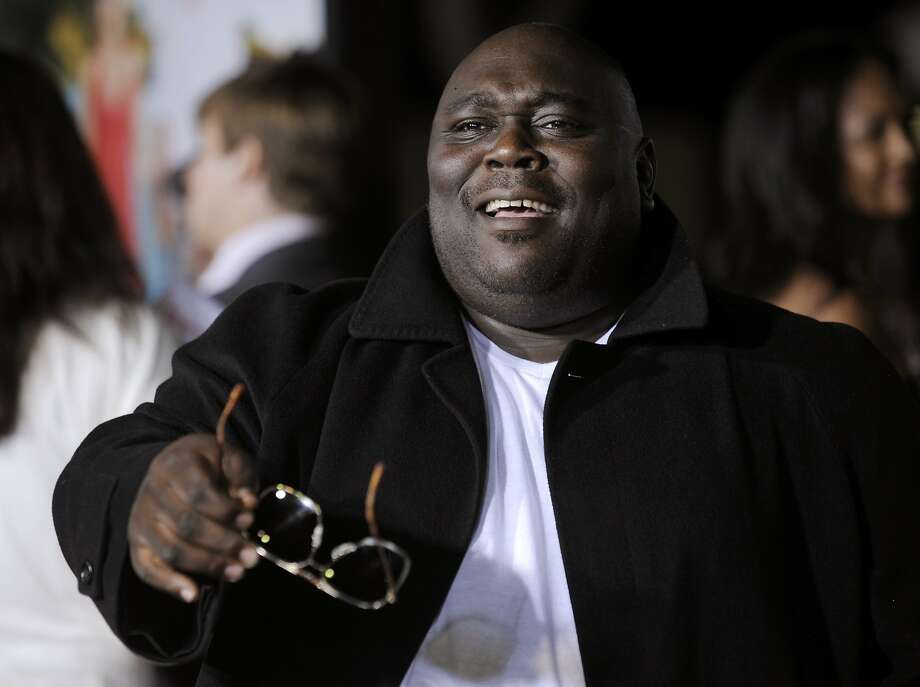 """Faizon Love, a cast member in """"Couples Retreat,"""" banters with photographers at the premiere of the film in Los Angeles, Monday, Oct. 5, 2009. (AP Photo/Chris Pizzello) Photo: Chris Pizzello, AP"""