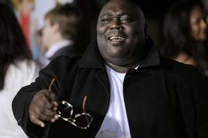 "Faizon Love, a cast member in ""Couples Retreat,"" banters with photographers at the premiere of the film in Los Angeles, Monday, Oct. 5, 2009. (AP Photo/Chris Pizzello)"