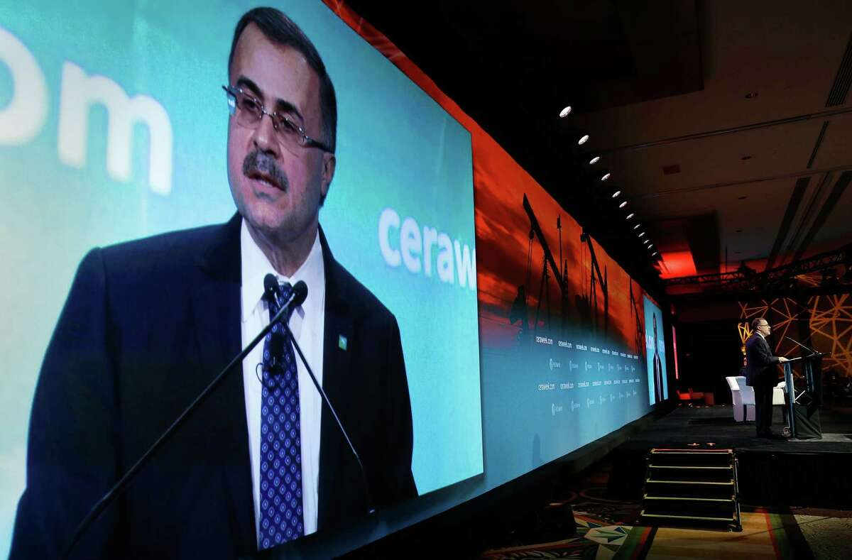 With his images projected behind him, Saudi Aramco CEO Amin Nasser gives his address as a featured speaker during Ceraweek held at the Hilton Americas Hotel Tuesday, Mar. 6, 2018 in Houston, Texas. Saudi Aramco is further investing in the petrochemical sector by buying a majority stake in the petrochemical giant SABIC. (Michael Wyke / For the Chronicle)