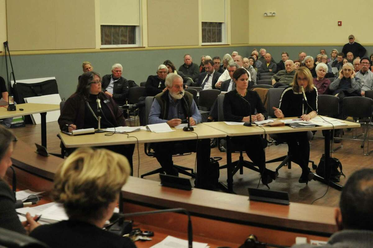 The public hearing on a proposed sewer pipeline to connect the Woodridge Lake housing development in Goshen to the Torrington system was closed Monday.