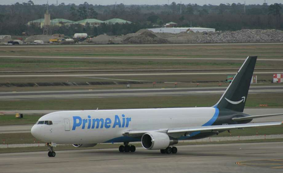An Amazon Prime Air Boeing 767 cargo plane taxis at Bush Intercontinental Airport in February 2018.Keep going to see other interesting aircraft that have flown over Houston. Photo: Bill Montgomery, Houston Chronicle