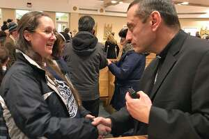 Bishop Frank Caggiano with parents of St. Joseph School in Brookfield in January.