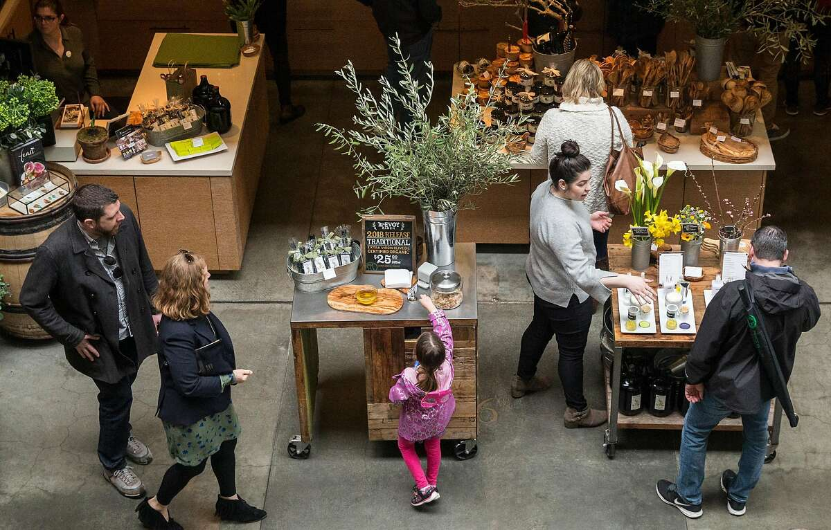 Patrons browse items at McEvoy Ranch inside the Ferry Building Saturday, March 3, 2018 in San Francisco, Calif.