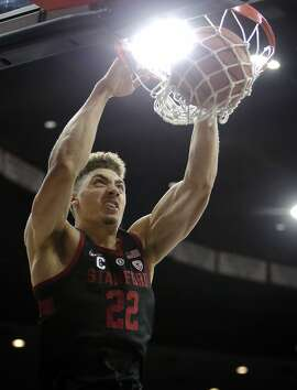 Stanford forward Reid Travis (22) in the first half during an NCAA college basketball game against Arizona, Thursday, March 1, 2018, in Tucson, Ariz. (AP Photo/Rick Scuteri)