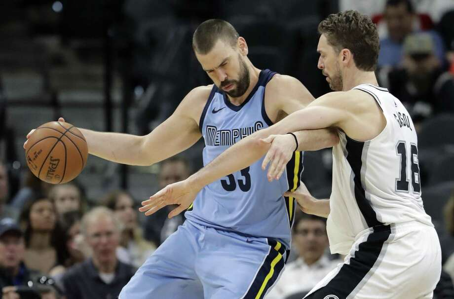 Memphis Grizzlies center Marc Gasol (33) is defended by San Antonio Spurs center Pau Gasol (16) during the second half of an NBA basketball game, Monday, March 5, 2018, in San Antonio. (AP Photo/Eric Gay) Photo: Eric Gay, STF / Associated Press / Copyright 2018 The Associated Press. All rights reserved.