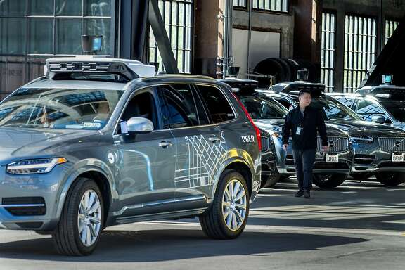 Uber test operator Robert Phung backs up the Volvo XC90 into the Uber Advanced Technologies Group headquarters at Pier 70, Tuesday, March 6, 2018, in San Francisco, Calif.