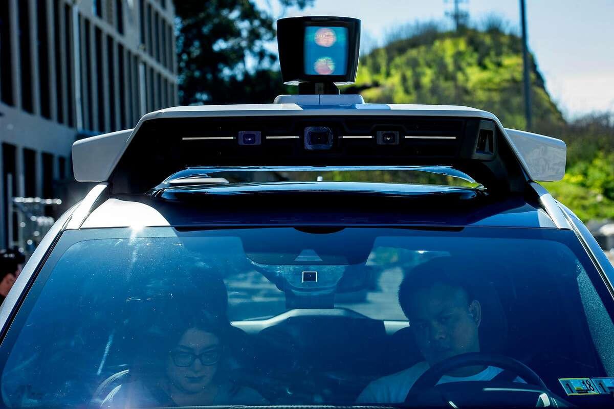 From left: Uber test operators Michelle Ortega and Robert Phung test the Volvo XC90 outside the Uber Advanced Technologies Group headquarters at Pier 70, Tuesday, March 6, 2018, in San Francisco, Calif.
