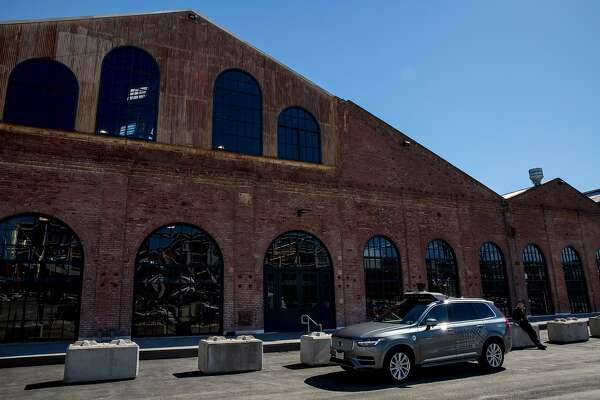 Uber's self driving Volvo XC90 outside the Uber Advanced Technologies Group headquarters at Pier 70, Tuesday, March 6, 2018, in San Francisco, Calif.