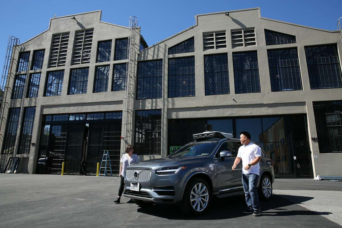 From left: Uber test operators Michelle Ortega and Robert Phung get out of the Volvo XC90 outside the Uber Advanced Technologies Group headquarters at Pier 70, Tuesday, March 6, 2018, in San Francisco, Calif.