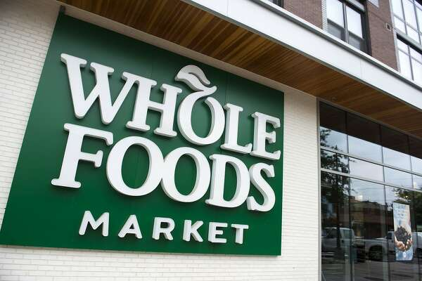 (FILES) In this file photo taken on June 16, 2017 a Whole Foods Market sign is seen in Washington, DC. US online giant Amazon on February 8, 2018 unveiled plans to launch grocery delivery to a number of US cities for its Prime subscriber using its recently acquired Whole Foods supermarket chain. While Amazon has previously offered limited grocery delivery, the new Prime Now service offers a wider selection of fresh items with service in one or two hours, stepping up competition against rivals such as Instacart and Peapod. / AFP PHOTO / SAUL LOEBSAUL LOEB/AFP/Getty Images