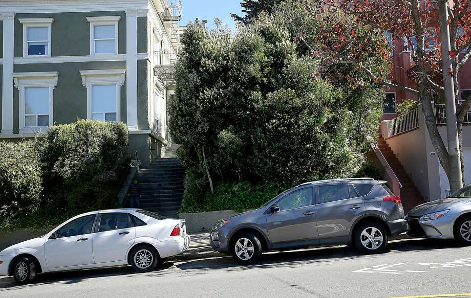 The San Francisco Public Utilities Commission is looking to impose a new storm-water tax on 500 vacant lots in the city, including this one on Ashbury Street (center). Photo: Liz Hafalia, The Chronicle