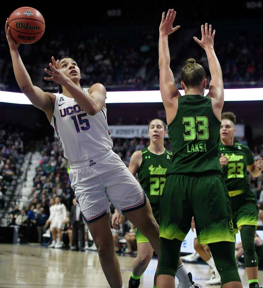 Connecticut's Gabby Williams (15), cuts through the defense of South Florida's Laia Flores (22), Kitija Laksa (33) and Tamara Henshaw (23) for a basket during the first half of an NCAA college basketball game in the American Athletic Conference tournament finals at Mohegan Sun Arena, Tuesday, March 6, 2018, in Uncasville, Conn. Photo: Jessica Hill, AP / AP2018