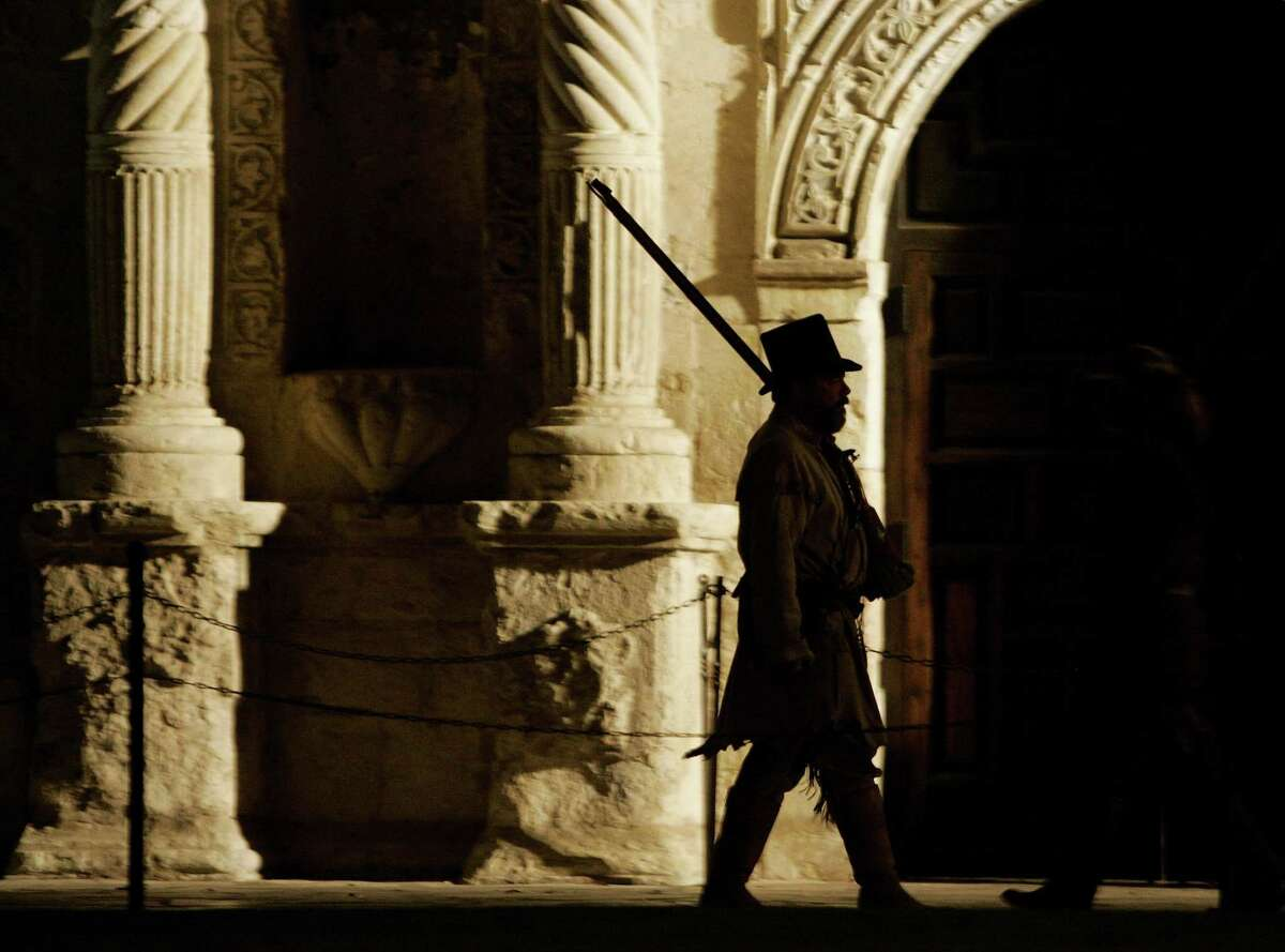 A member of the San Antonio Living History Association portrays a sentry in front of the Alamo during a pre-dawn memorial service at Alamo Plaza March 6, 2007. The 13-day siege of the Alamo ended March 6, 1836.