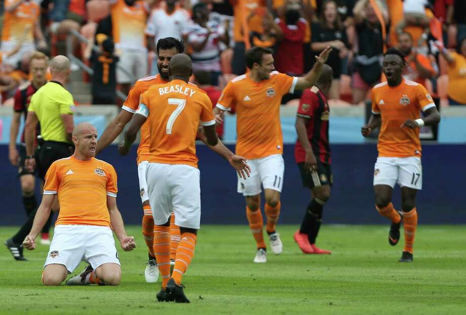 A goal by Philippe Senderos, left, helped the Dynamo to a 3-0 lead in the first 28 minutes and masked an uneven second-half performance in their 4-0 victory over Atlanta United in the season opener on Saturady. Photo: Yi-Chin Lee, Staff / © 2018 Houston Chronicle