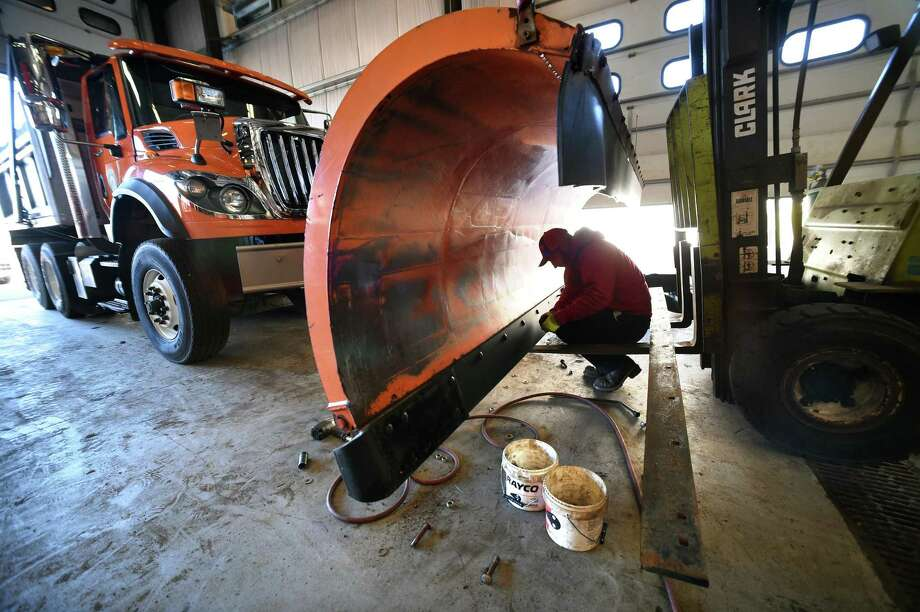 Nick Dadio installs bolts for a new cutting edge on a plow at the North Haven Department of Public Works on March 6, 2018 in preparation for heavy snow tomorrow. Photo: Arnold Gold / Hearst Connecticut Media / New Haven Register