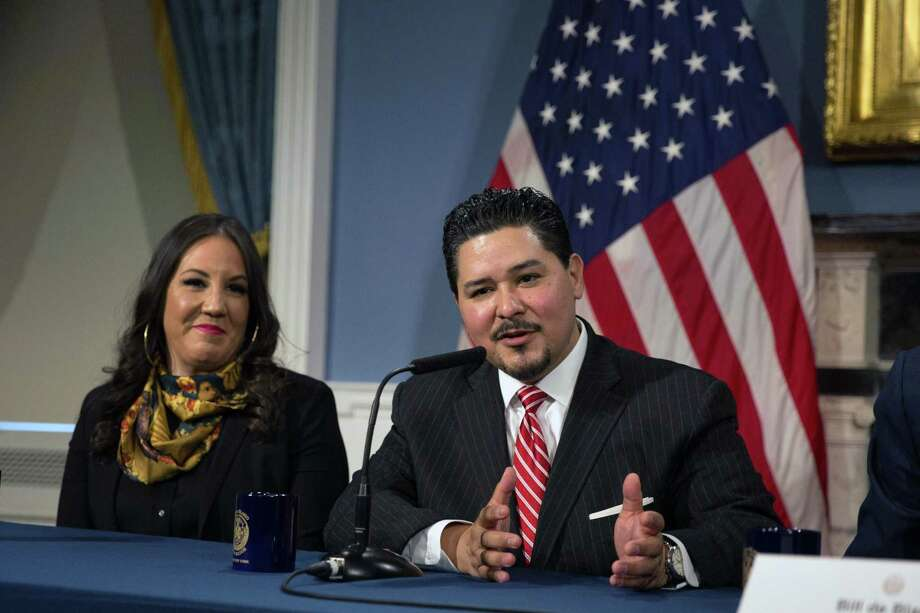 Richard Carranza, the incoming schools chancellor, speaks at a news conference at City Hall in New York on Monday, March 5, 2018, as his wife, Monique Carranza, looks on. Rushing to name a new chancellor just days after his first pick to head the citys schools turned him down on live television, Mayor Bill de Blasio on Monday selected Carranza, the Houston schools superintendent, to lead the nations largest school system. Photo: KEVIN HAGEN / KEVIN HAGEN / NYT / NYTNS