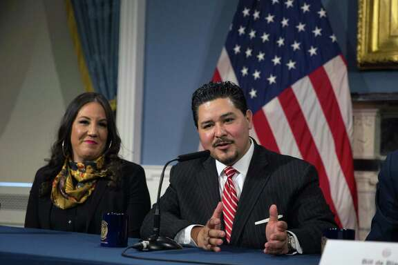 Richard Carranza, the incoming schools chancellor, speaks at a news conference at City Hall in New York on Monday, March 5, 2018, as his wife, Monique Carranza, looks on. Rushing to name a new chancellor just days after his first pick to head the citys schools turned him down on live television, Mayor Bill de Blasio on Monday selected Carranza, the Houston schools superintendent, to lead the nations largest school system.