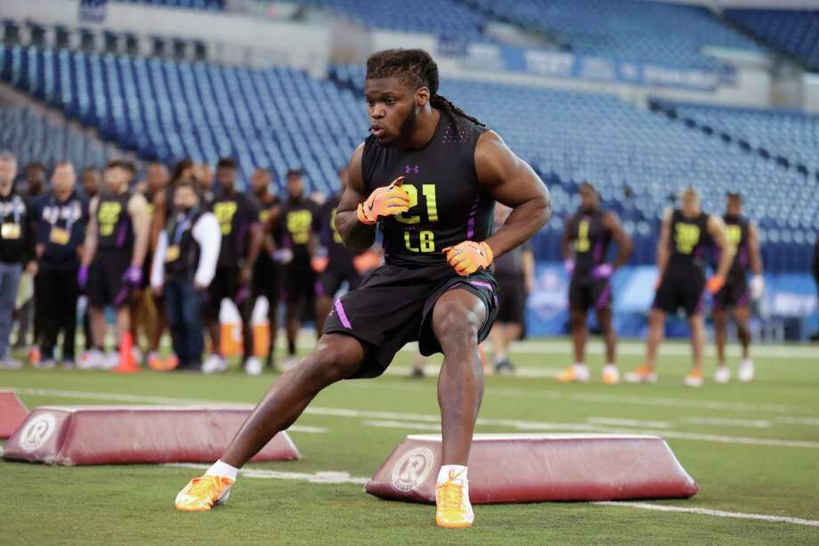 Texas linebacker Malik Jefferson runs a drill at the NFL football scouting combine in Indianapolis, Sunday, March 4, 2018. (AP Photo/Michael Conroy) Photo: Michael Conroy, STF / Copyright 2018 The Associated Press. All rights reserved.