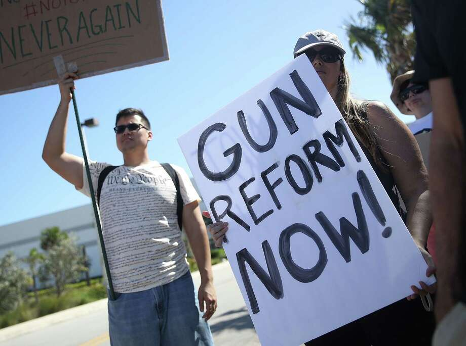 POMPANO BEACH, FL - FEBRUARY 25:  Activists protest in front of Kalashnikov USA, a gun manufacturer that makes an AK-47 rifle, on February 25, 2018 in Pompano Beach, Florida. The protesters are rallying for gun reform in light of the mass shooting at Marjory Stoneman Douglas High School on February 14. Police arrested 19-year-old former student Nikolas Cruz for killing 17 people with an AR-15 rifle.  (Photo by Joe Raedle/Getty Images) Photo: Joe Raedle / 2018 Getty Images