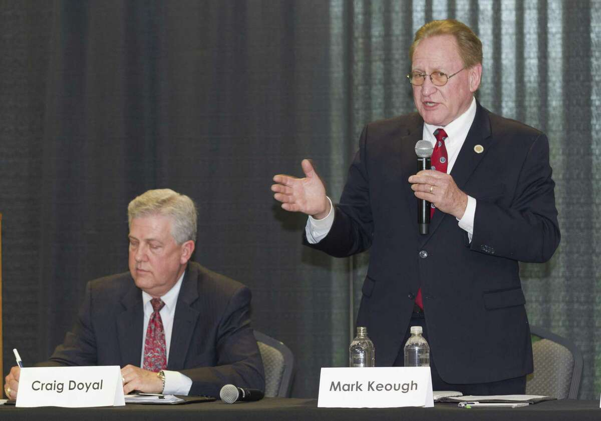 State Rep. Mark Keough, Republican candidate for Montgomery County Judge, speaks next to incumbent Craig Doyal during the Conroe/Lake Conroe Chamber of Commerce candidate forum at the Lone Star Convention & Expo Center, Tuesday, Feb. 6, 2018, in Conroe.