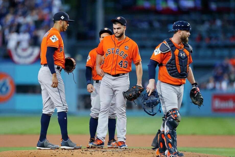 Meetings like this one with pitcher Lance McCullers Jr. (43) that involve the catcher  and multiple infielders should take place less often under the new limitations. Photo: Brett Coomer, Houston Chronicle / © 2017 Houston Chronicle