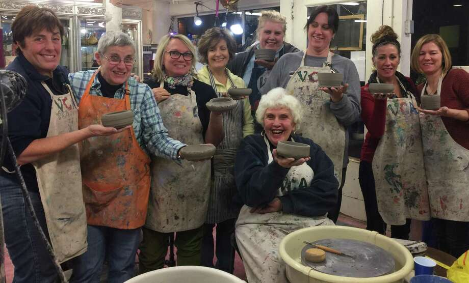 "The Village Center for the Arts in New Milford will present a ""Wheel with Friends"" pottery class for adults, March 9 and 16 at 7 p.m. Above, past participants proudly show their pottery pieces. Photo: Courtesy Of Village Center For The Arts / The News-Times Contributed"