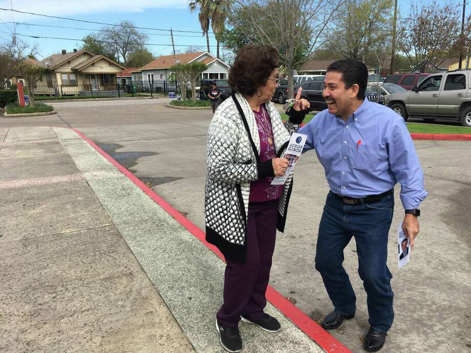 Adrian Garcia, a candidate for Harris County Commissioner, greets Maria Alanis, 78, of the East End, as she heads in to vote at Ripley Neighborhood Centers Inc. on Mar. 6, 2018. Photo: Gabrielle Banks / Gabrielle Banks / Houston Chronicle