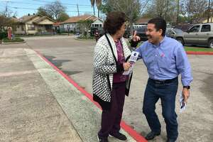 Adrian Garcia, a candidate for Harris County Commissioner, greets Maria Alanis, 78, of the East End, as she heads in to vote at Ripley Neighborhood Centers Inc. on Mar. 6, 2018.