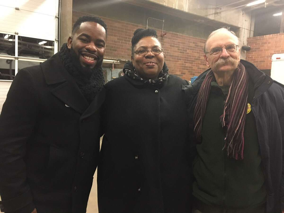 Randall Furlow, Alder Evette Hamilton and Art Perlo, from left to right, stand together after vote in Ward Committee election for Ward 24.