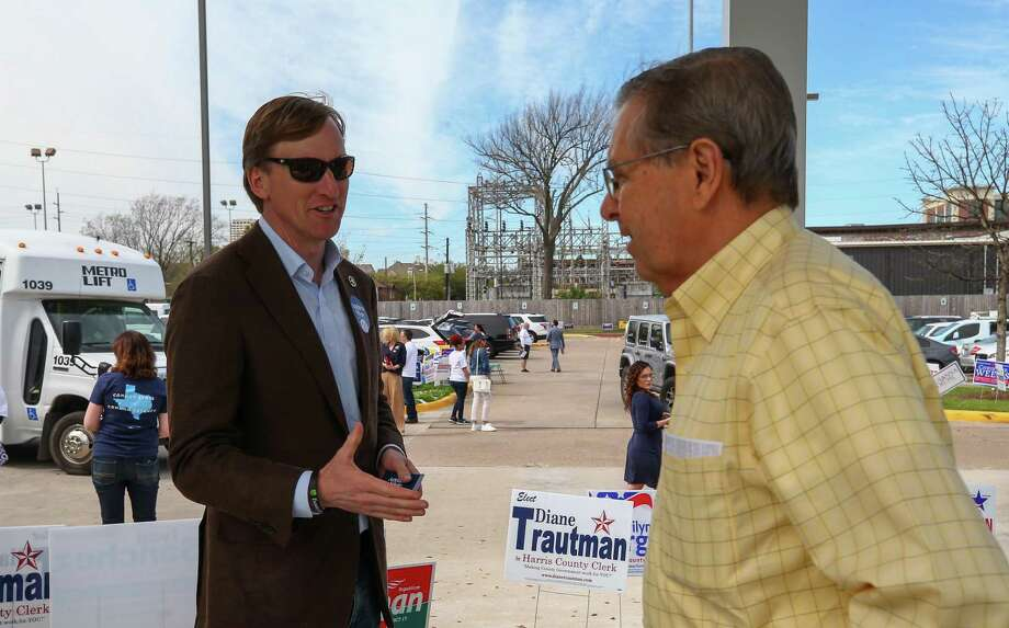 Gubernatorial candidate Andrew White, left, introduces himself to incoming voters outside the West Gray Recreation Center  Tuesday, March 6, 2018, in Houston. ( Godofredo A. Vasquez / Houston Chronicle ) Photo: Godofredo A. Vasquez / Houston Chronicle