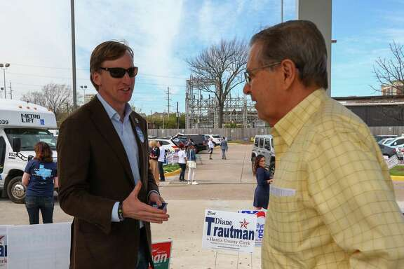Gubernatorial candidate Andrew White, left, introduces himself to incoming voters outside the West Gray Recreation Center  Tuesday, March 6, 2018, in Houston. ( Godofredo A. Vasquez / Houston Chronicle )