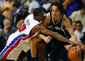 Lindsey Hunter pressures Manu Ginobili during fourth quarter action game four NBA Finals on Thursday, June 16, 2005 at the Palace at Auburn Hills. BAHRAM MARK SOBHANI/STAFF