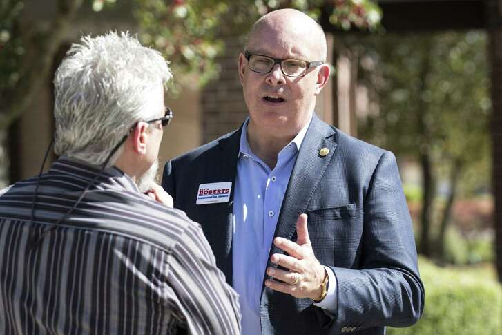 Kevin Robets, a Republican running for the 2nd Congressional District seat in the U.S. House of Representatives, talks to voters outside the polling place at Resurrection Lutheran Church on Tuesday, March 6, 2018, in Houston. ( Brett Coomer / Houston Chronicle )