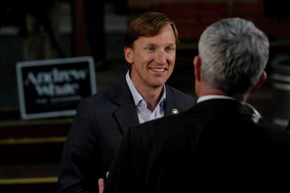 Andrew White, a democratic candidate for governor, talks to a television reporter before an election watch party at Raven Tower, Tuesday, March 6, 2018, in Houston.