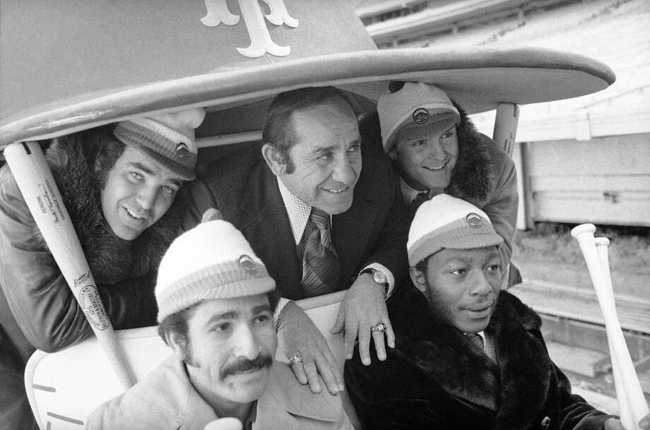 "FILE - In this January 1973 photo, New York Mets manager Yogi Berra, center, poses in the team cart at Shea Stadium in New York with four who signed with the baseball team earlier in the day. They are, back row and from left: Ed Kranepool, Berra, and Tug McGraw. Front row, from left: Felix Millan and John Milner. Cleon Jones also signed, but was not present for the picture session. Bullpen buggies are rolling back, and Cleveland Indians manager Terry Francona is positively bug-eyed about the prospect. ""I love it. I love it. I love it,"" he said Tuesday, March 6, 2018. Nearly a quarter-century since relievers stopped catching rides to the mound, the bullpen cart will become the latest retro feature to make a return to the big leagues. (AP Photo, File) Photo: Jim Wells / AP1973"